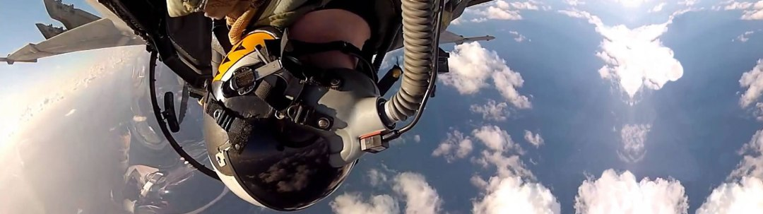About us: Military fighter jet pilot upsidedown, demonstrating the boldness of GetWebMax.com