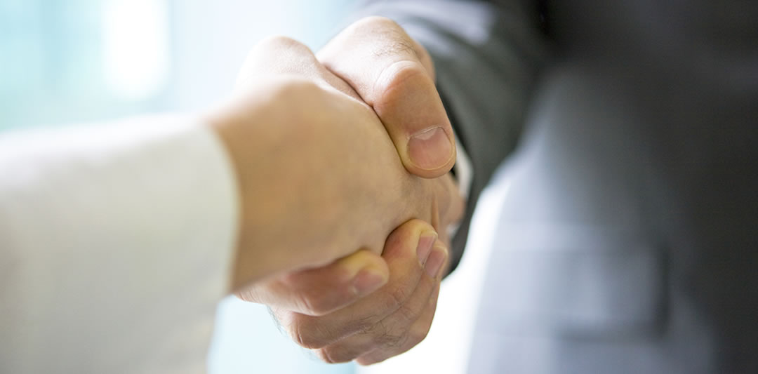 Image of a handshake between two business people indicating trust when it comes to business