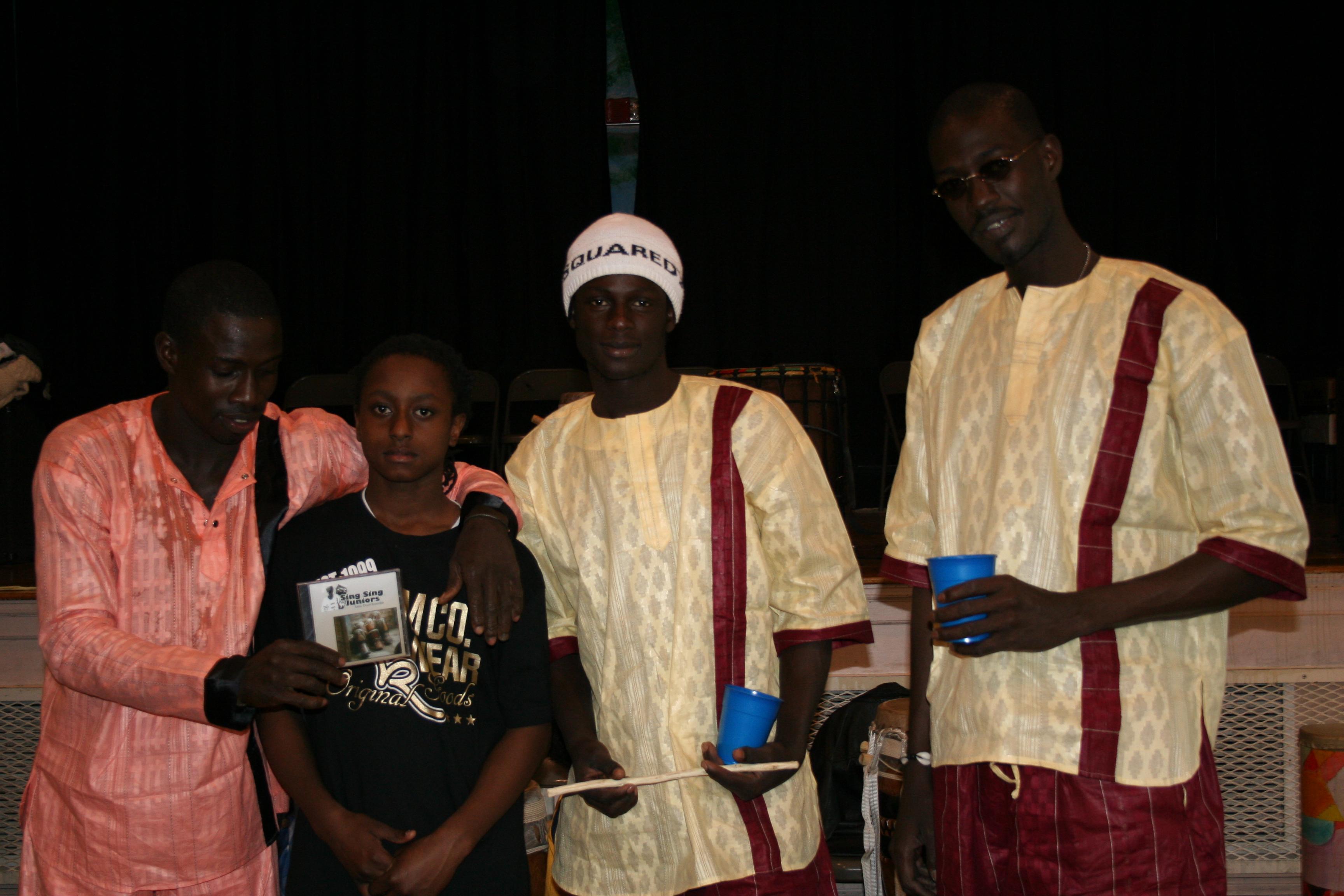 Aziz, Malick and Moustapha with student