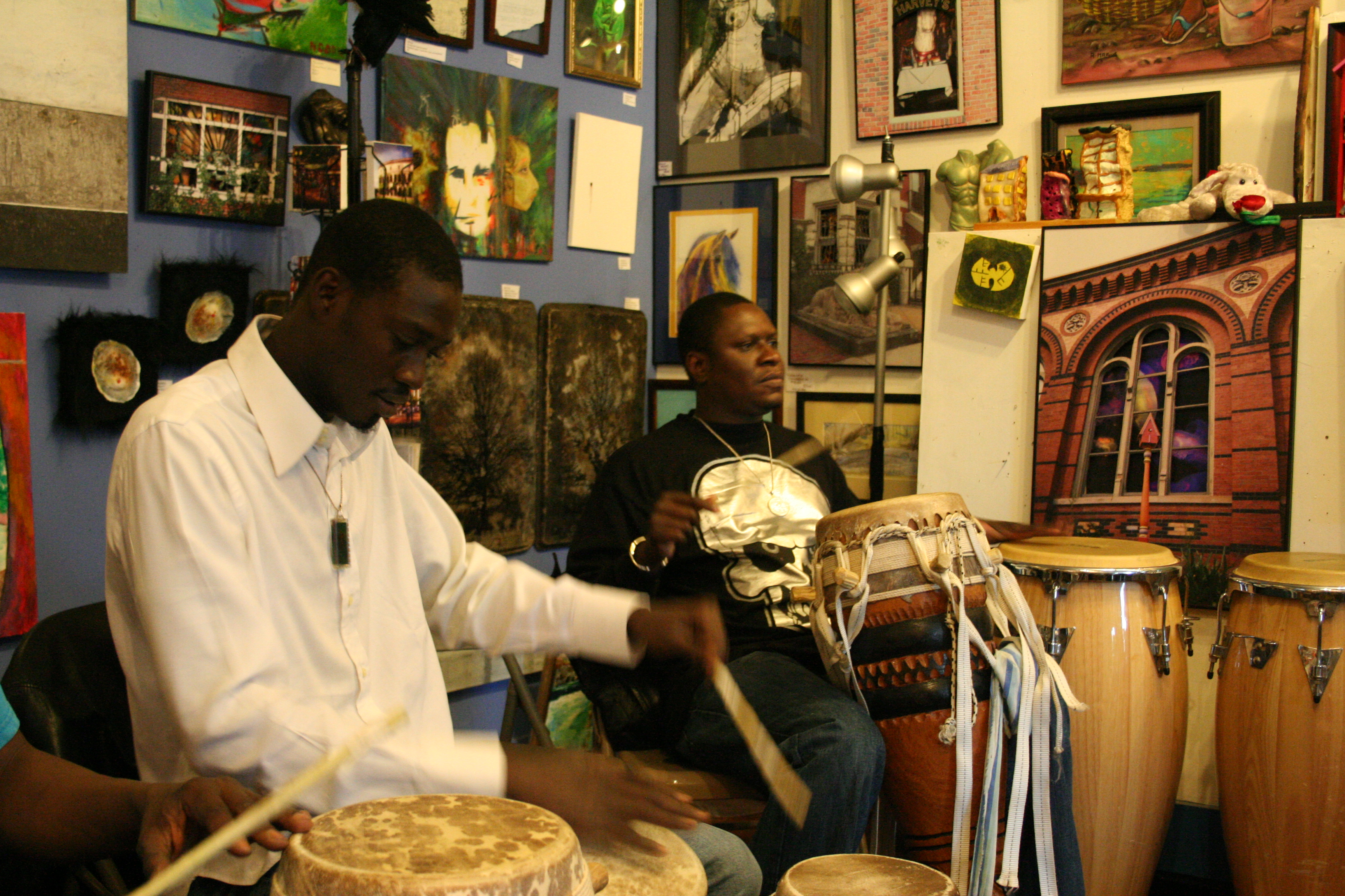 Moustapha teaches drum class.