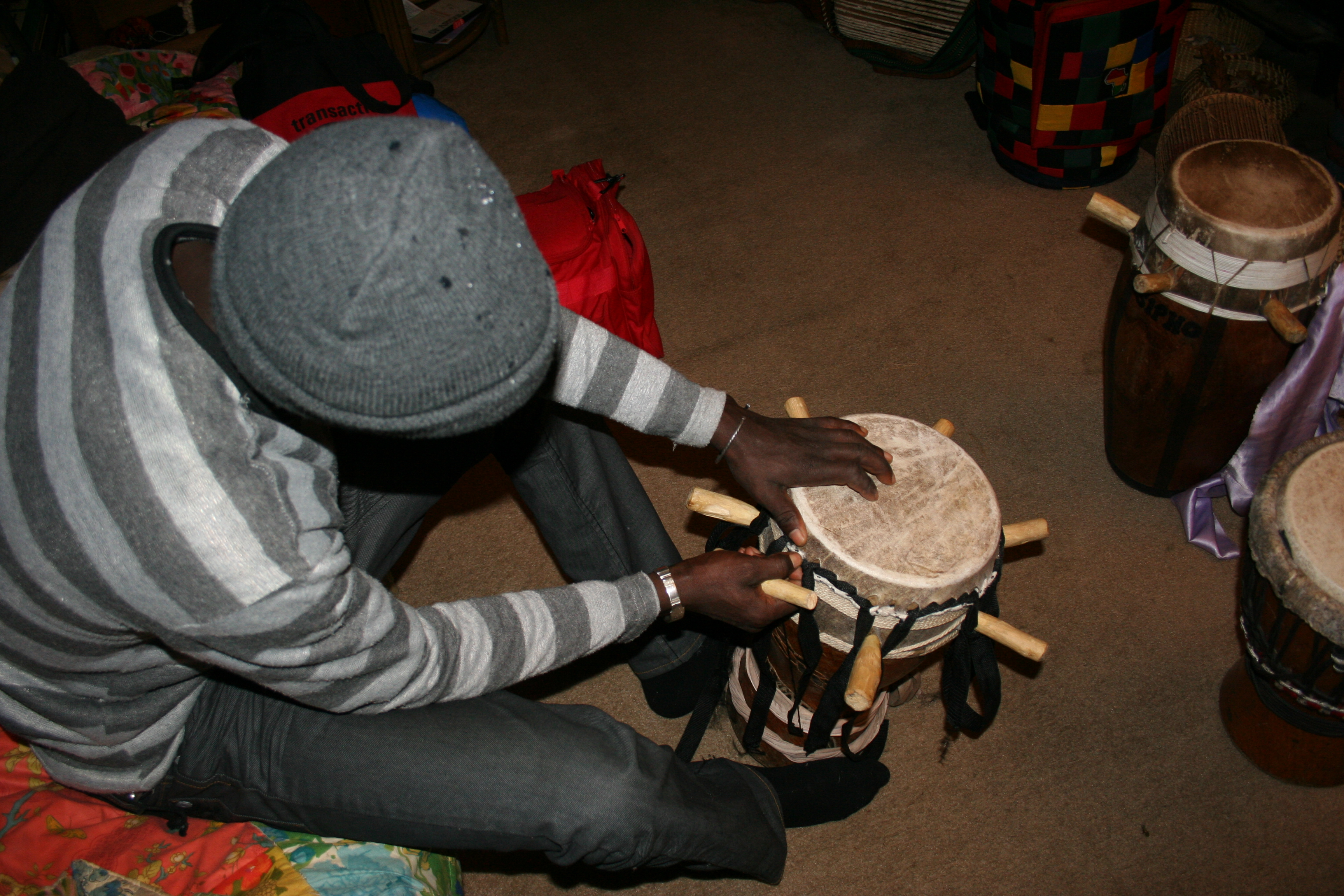 Malick working on a drum.