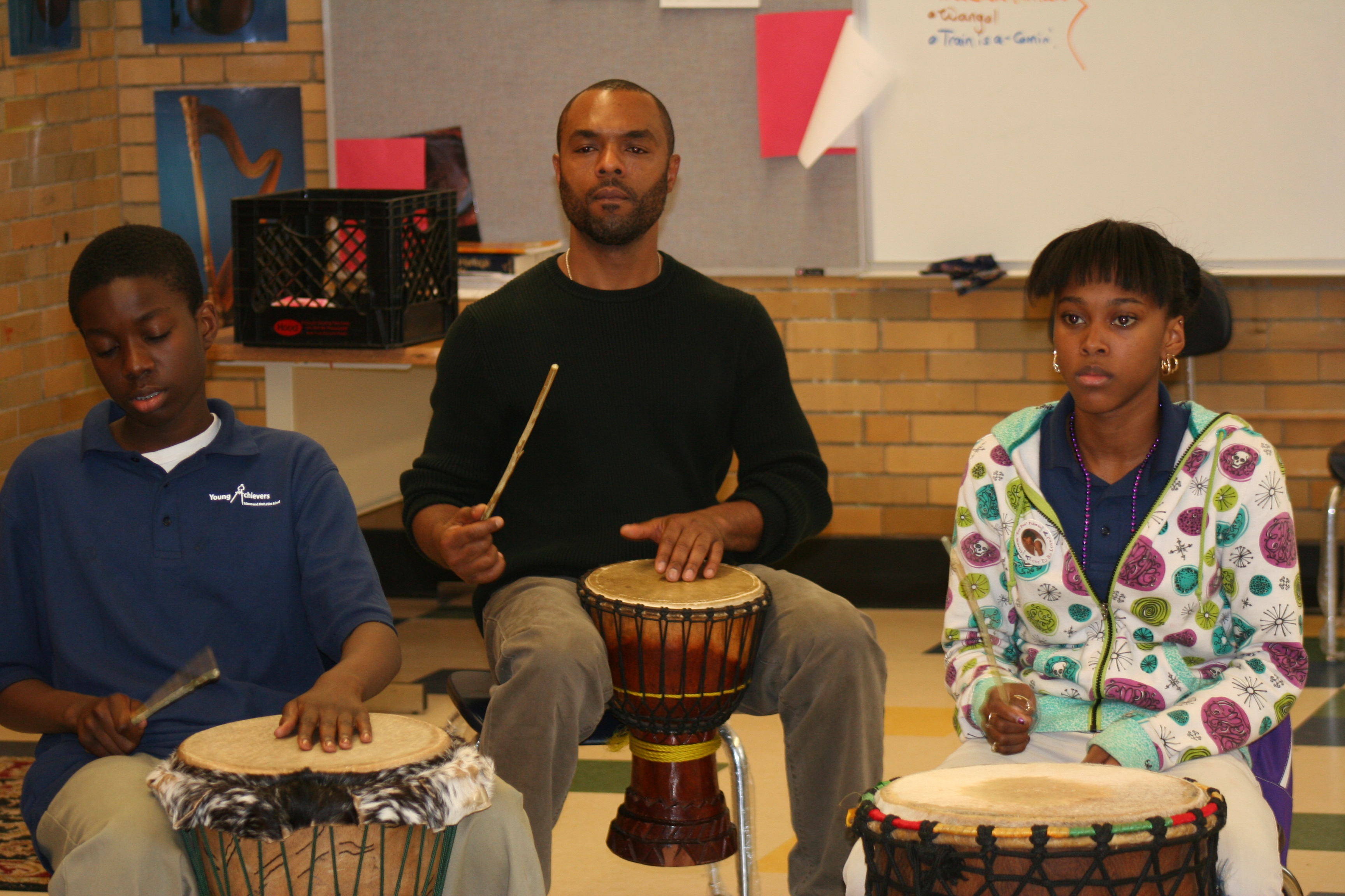 Teacher Kimani Lumsden works on rhythms with his students.