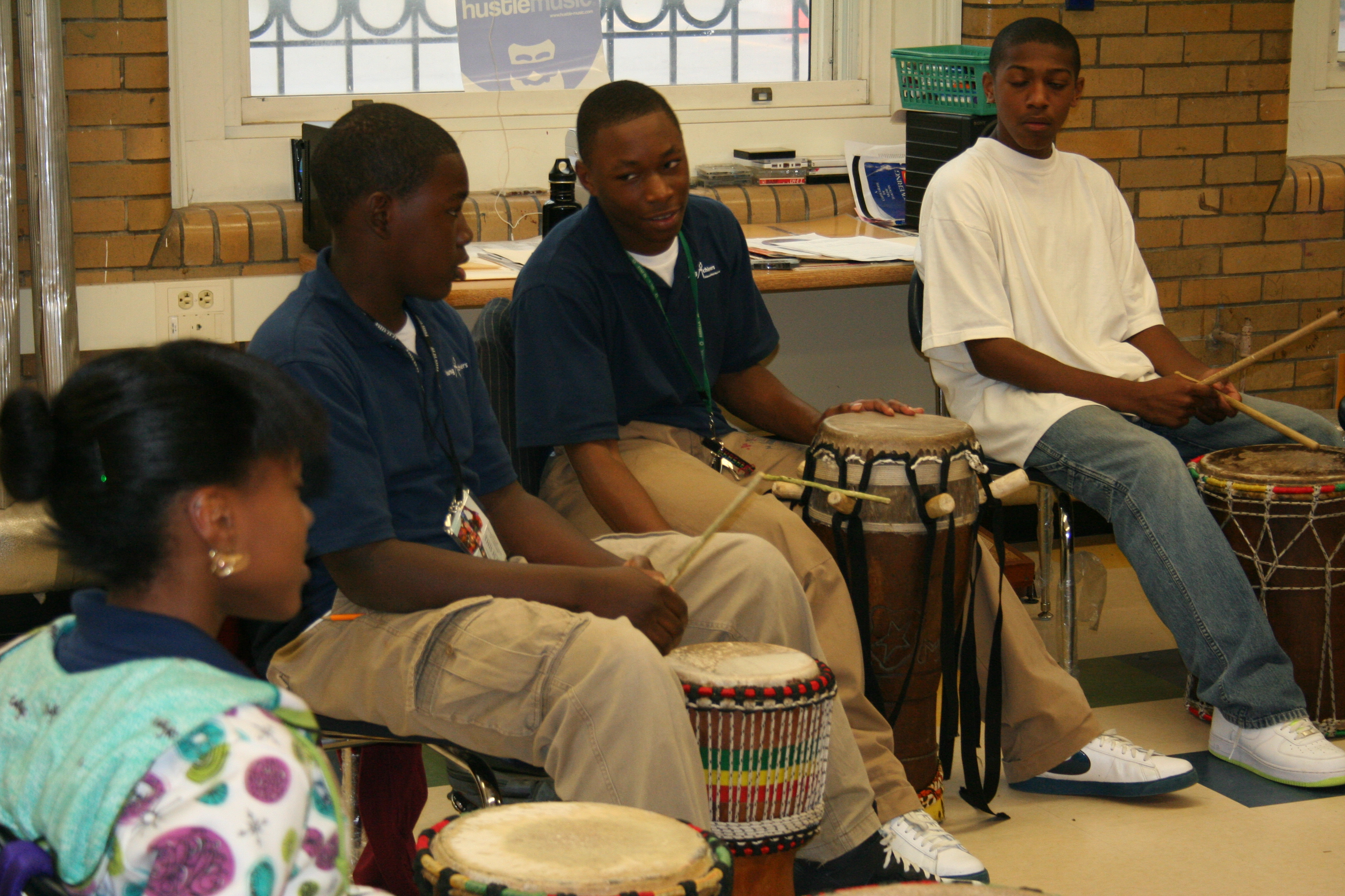 Students work on the sabar drums.