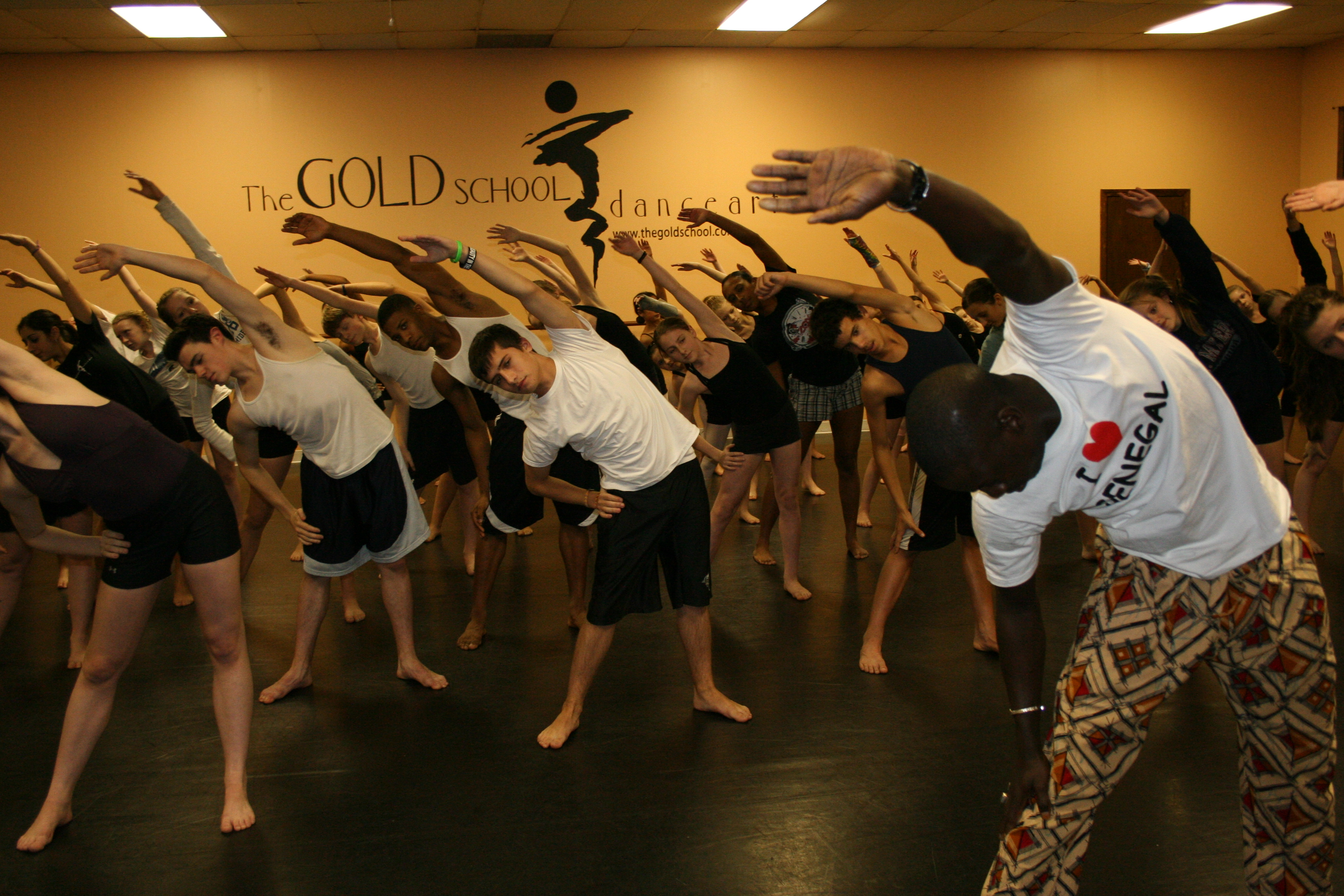Aziz leads students in warm-up excercises.