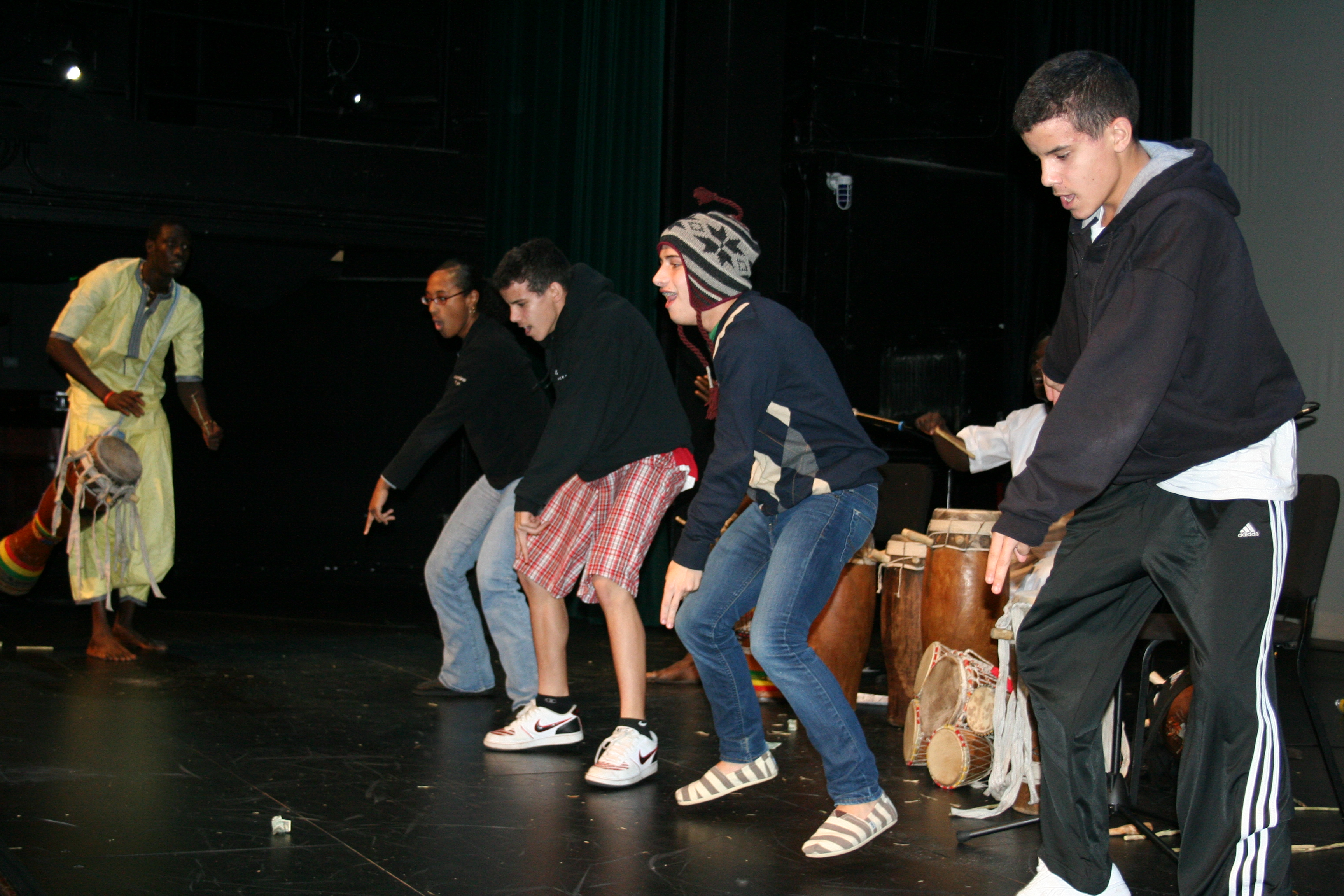 Dancers from the Gold School demonstrate their sabar steps.