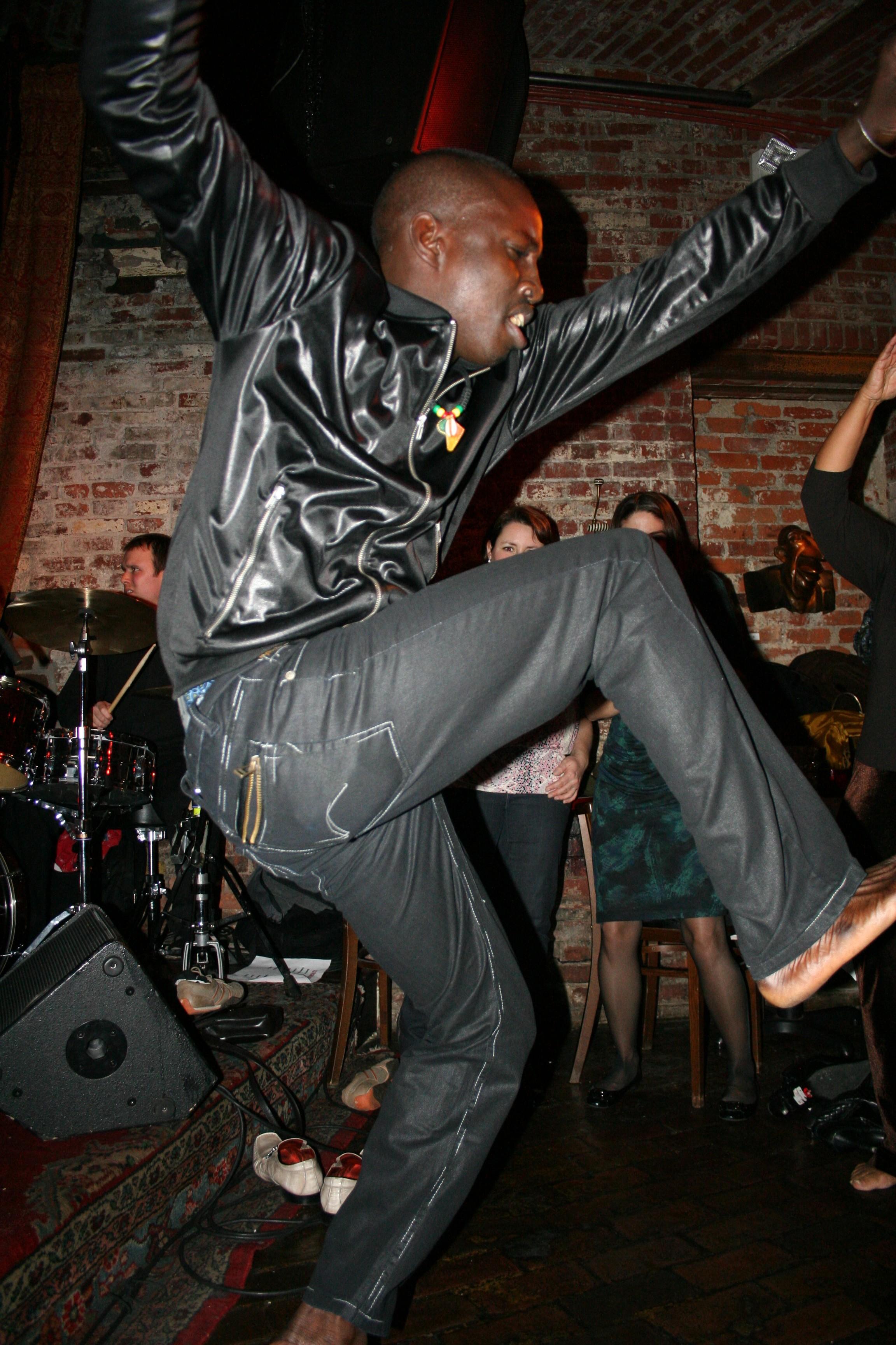 Aziz Faye dances to Group Saloum at the Beehive.