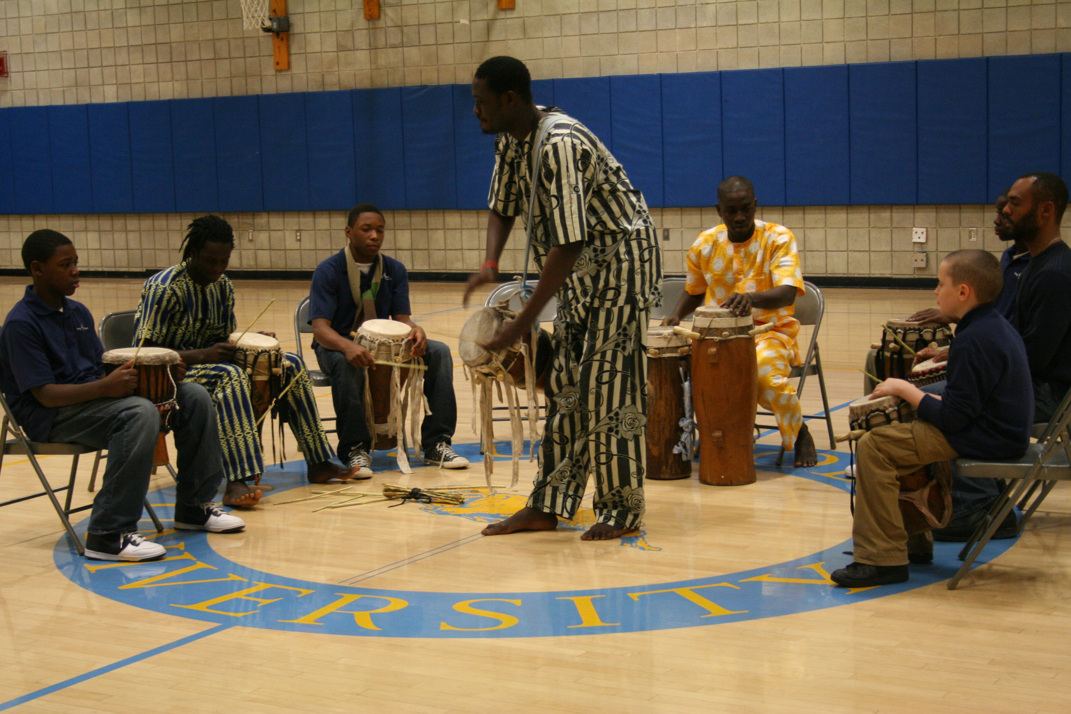 Moustapha leads Young Acievers School students.