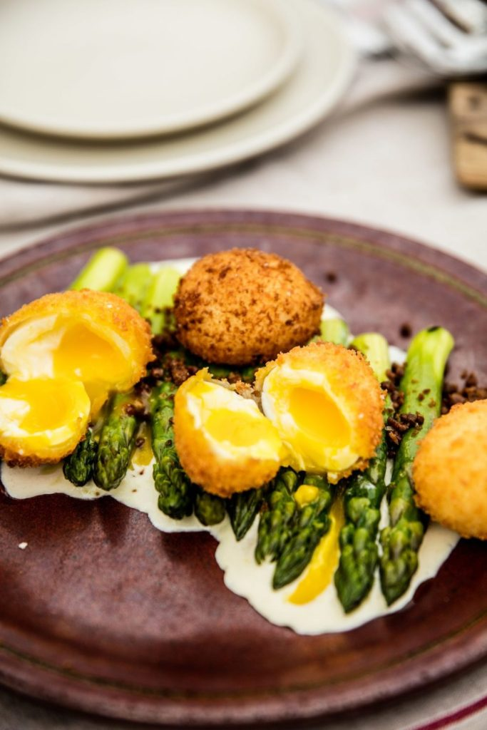 Gluten-Free Crispy Soft-Boiled Eggs and Olive Oil– Poached Asparagus with Cambozola Crema