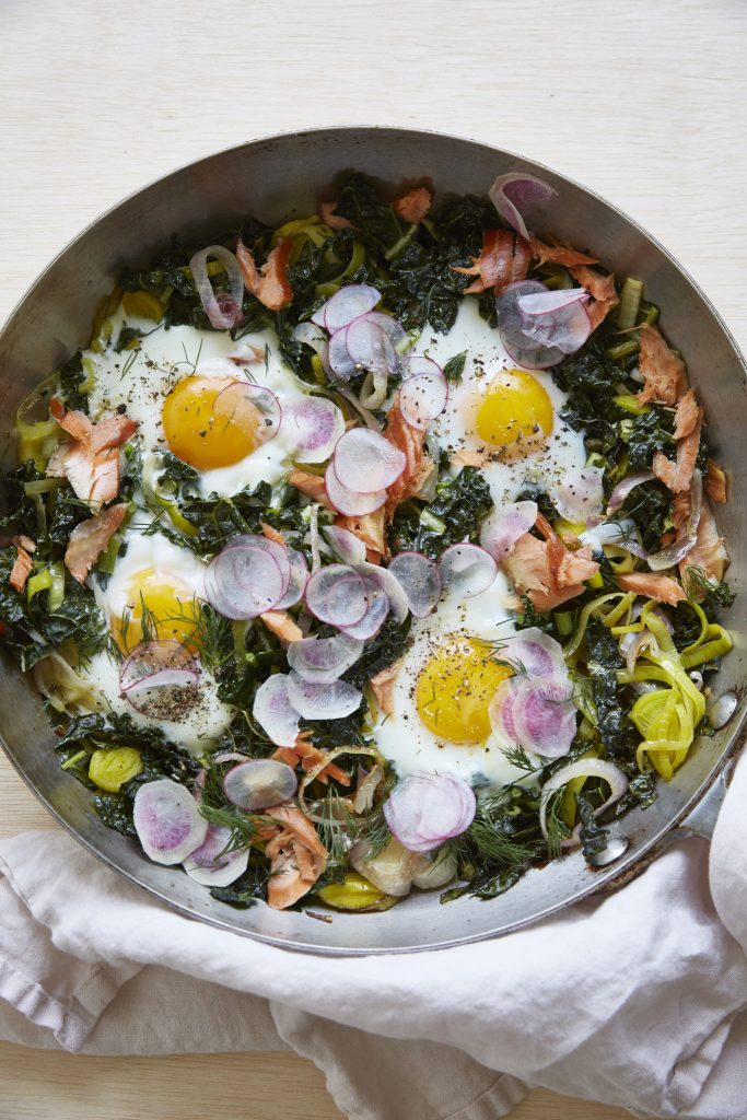 Baked Eggs with Caramelized Onion, Kale, and Smoked Salmon
