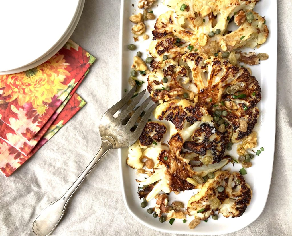 Roasted Cauliflower with Caper Vinaigrette, Walnuts, and Golden Raisins