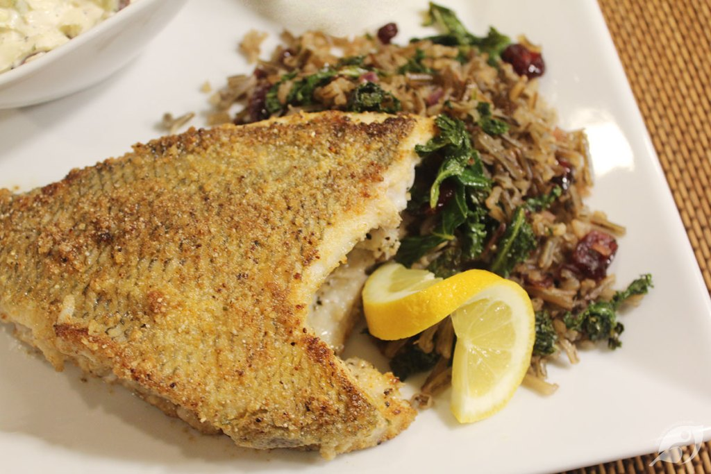 Lake-Harvested Wild Rice, Cranberry, and Kale Pilaf served with fresh-caught Bluegill
