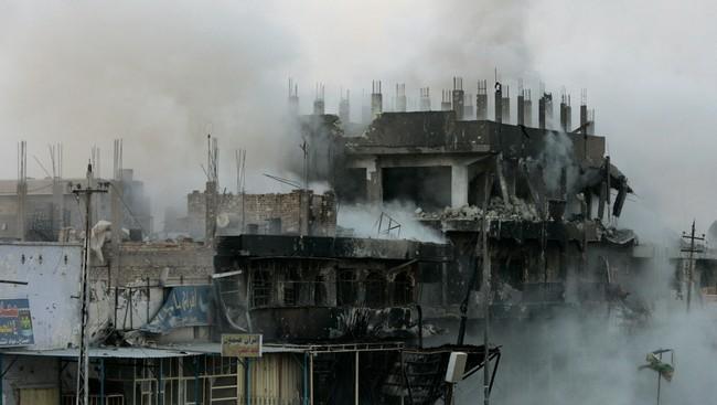 Utbombet hus som har blitt angrepet av en Hellfire-rakett (Foto:  Petr David Josek/AP)