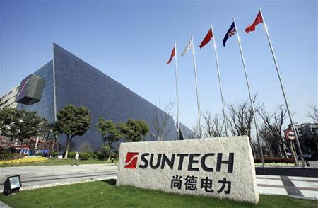 A man walks past Suntech Power Holdings headquarters in Wuxi