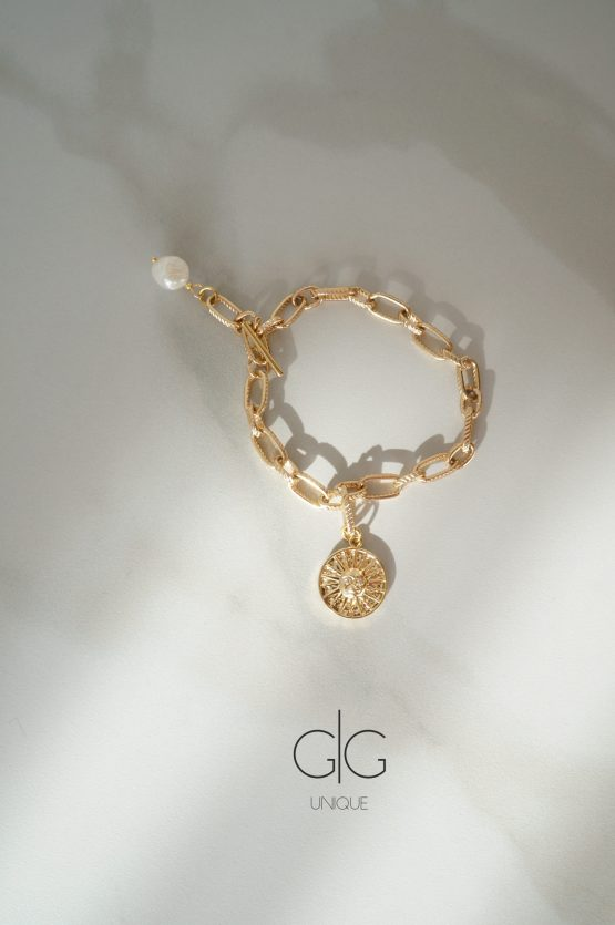 Stainless steel bracelet with freshwater pearl and sun symbol - GG UNIQUE
