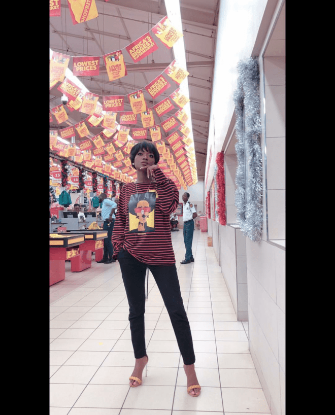 Efya served casual looks in this oversized stripped shirt over pants and heels