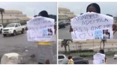 [Video] 'Please forgive me' – Lady storms the street with placard to beg her man