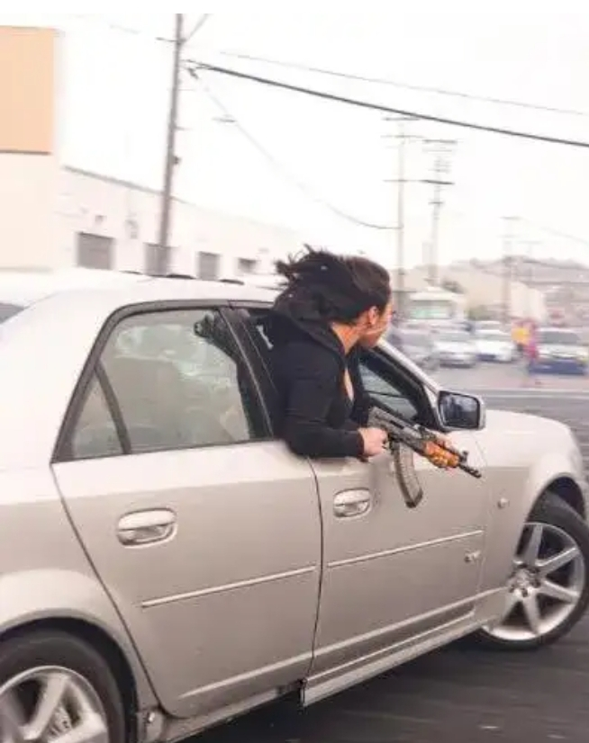 A passenger leaning out of a cadi holding an AK47 triggers police action in US