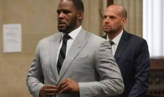 R. Kelly trial: Woman says singer pressured her to have abortion