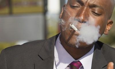businessman smoking cigarette