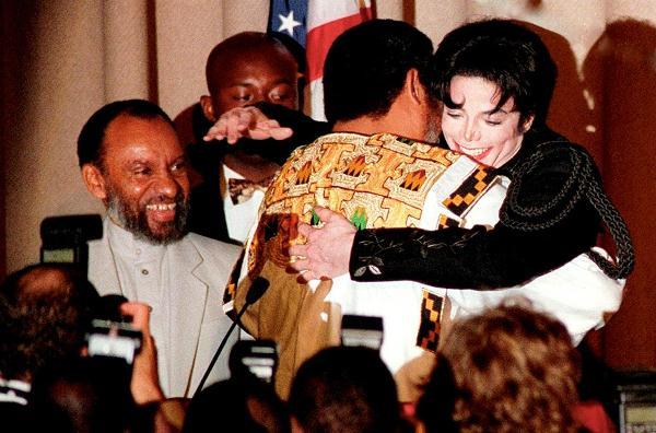 John Rawlings hugs Michael Jackson