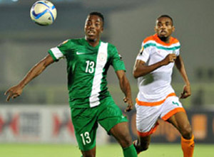 HAT-TRICK-STAR: Chisom Chikatara (l) beats a Nigerien defender to score his first goal. Nigeria won 4-1.