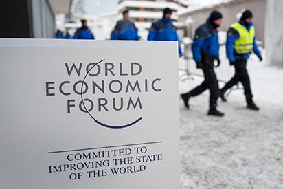 wiss police officer take position during the World Economic Forum (WEF) annual meeting in Davos, on January 20, 2016. A string of jihadist attacks and rising risks to the global economy overshadow the opening of the annual gathering of the world's rich and powerful in a snow-blanketed Swiss ski resort. Even as heads of state, billionaires and Hollywood megastar Leonardo DiCaprio were arriving, the International Monetary Fund (IMF) sounded the alarm on January 19, 2016 about perils in the major emerging market economies and lowered its outlook for global economic growth this year. / AFP / FABRICE COFFRINI