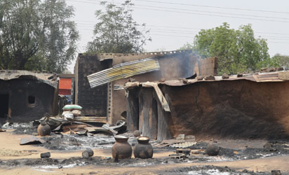 File : NIGERIA, Maiduguri : This photo shows razed homes in Mainok, outside Maiduguri, Borno State, Nigeria, on March 6, 2014. At least 74 people were killed in attacks on March 1, 2014 in villages near Maiduguri, blamed on Boko Haram militants, taking the overall death toll this year beyond 300, with no apparent end in sight to the carnage. Gunmen dressed in military fatigues and armed with powerful assault rifles, rocket-propelled grenades and explosives laid siege to the village of Mainok, killing 39. AFP PHOTO