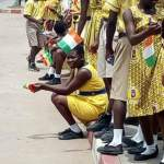 Pupils abandon classes to wave at Ouattara on the streets
