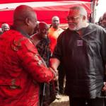 Rawlings and Mahama share laughter, handshake