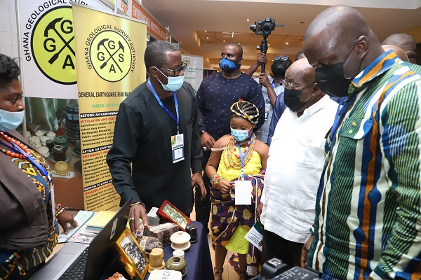 President Akufo-Addo being briefed by Dr Daniel Boamah (left), Director General, Forestry Commission. Looking on is Mr Samuel Abu Jinapor (right), Minister for Lands