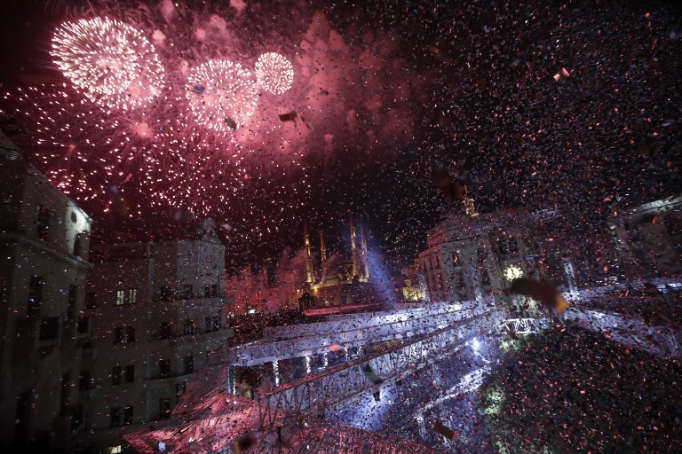 Fireworks explode over downtown Beirut, Lebanon, during New Year's celebrations on January 1, 2019. (Photo by Anwar AMRO / AFP)