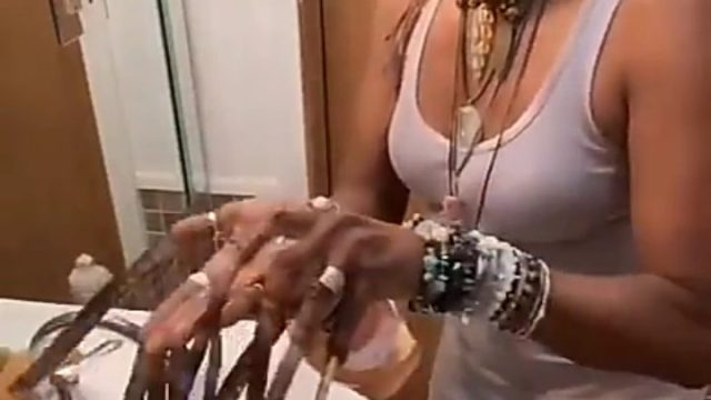 Lady with lengthy fingernails reveals how she washes her fingers.