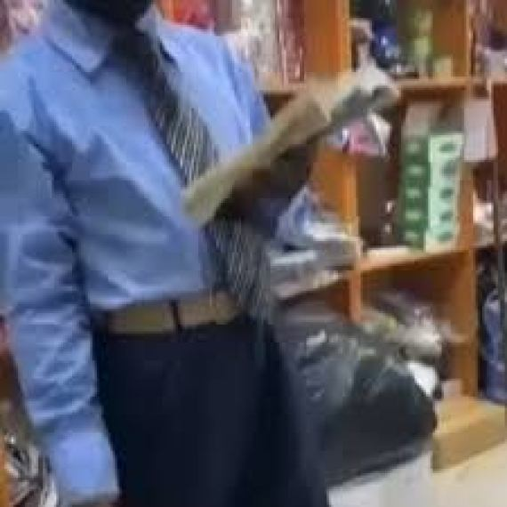 Watch Video of well-dressed street pastor preaching with textbook instead of Bible