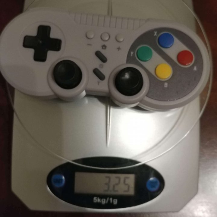 On the scale: TechKen's SNES controller for Nintendo Switch weighs 3.25 oz