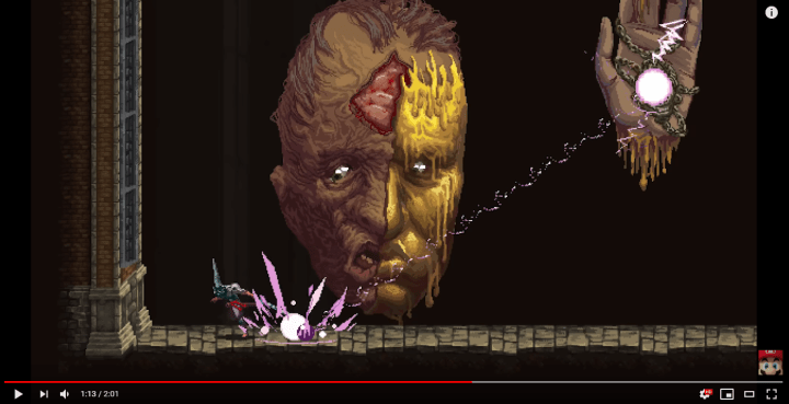 A giant boss with laser hands in Blasphemous