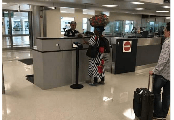 VIRAL Photo: This Woman At US Airport Carrying Her Bag On Her Head Is Everything