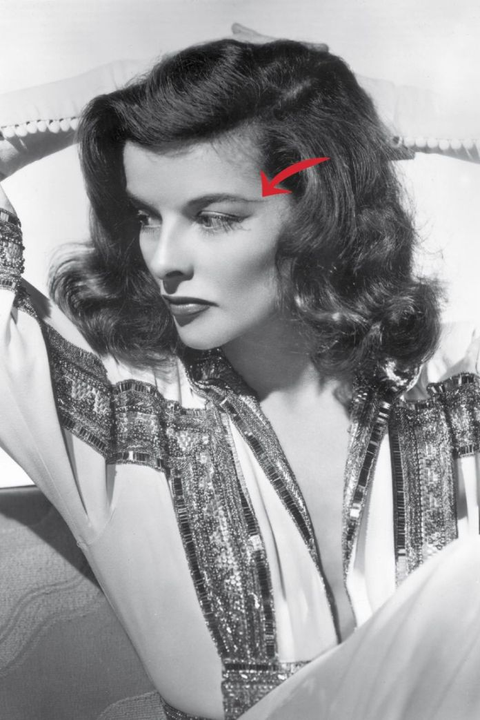 "Katharine Hepburn is using a tried-and-true makeup trick here. ""Lengthening the tail end of your brows lifts the eyes and adds drama to the face,"" Scott says. Since Hepburn's a star on screen and stage, she goes for a theatrical length and height, aiming her brow at her temple. For an everyday eyelift, aim the tail at the upper ear, Scott suggests. Use a pencil like Maybelline New York Brow Precise, and don't go quite so far unless you're in fact a drama queen, too."