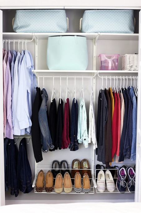 The easiest way to take your closet from junky to jaw-dropping? Pick your colors wisely: All-white hangers are clean, while light blue containers add an element of surprise. See more at A Girl and Her Blog »