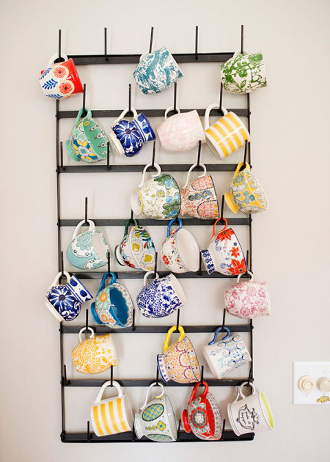 This blogger's coffee cup collection doubles as colorful wall art, punching up a plain wall in her mostly-neutral space.  See more at Baked Brie »