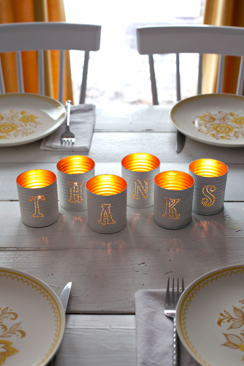 "Spell out ""thanks"" with these tin can candle holders for Thanksgiving, or other fall words like ""autumn"" or ""boo"" depending when you want to use them to decorate. Get the tutorial at a Beautiful Mess »"