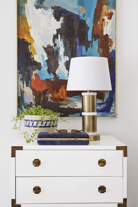 You'll be shocked how different your gold table lamp and dresser look when a huge modern painting is hung behind it. Suddenly you've got a vignette instead of simply a plain surface. Get the look: modern abstract painting, $47, wayfair.com