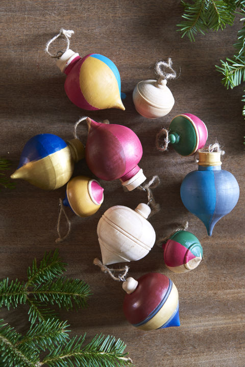 Reinvigorate wooden ornaments with a cheery color scheme and use twine to hang. Unlike glass baubles, they can withstand a fall on the floor. What you'll need: paint set ($10, amazon.com), finial ornament ($16, birchlane.com)