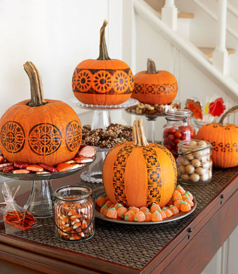 A candy buffet gets some Halloween spirit, thanks to no-carve pumpkins. To create the patterns, tape on multiple store-bought stencils (simple graphic designs work best), brush over them with black acrylic paint and you're done. Get the tutorial »