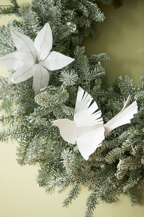 Adopt a white Christmas theme and keep things monochrome. The details on these folded doves pop even more in a neutral hue. Get the tutorial » What you'll need:pinecones ($9,amazon.com), snow spray ($10,amazon.com)