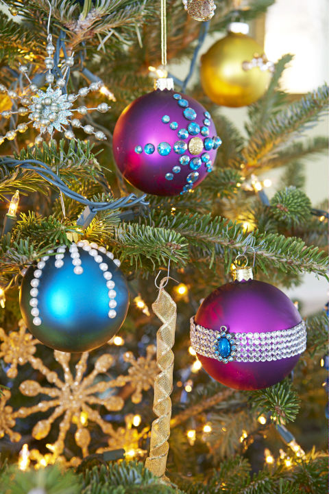 Self-adhesives come in handy yet again. Dot colored balls with sticky-backed jewels for a little extra sparkle. Get the tutorial » What you'll need: colorful ornaments ($5 for 24, amazon.com), self-adhesive jewels ($5, amazon.com)
