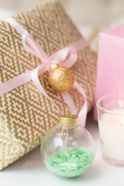 Don't throw out those gift-wrapping scraps just yet. Fill glass ornaments with ribbon curls or colorful confetti. If there's no more room on the tree, make ornaments to match your tablescape. Get the tutorial » What you'll need: clear ornaments ($7 for 6, amazon.com), confetti ($8, amazon.com)