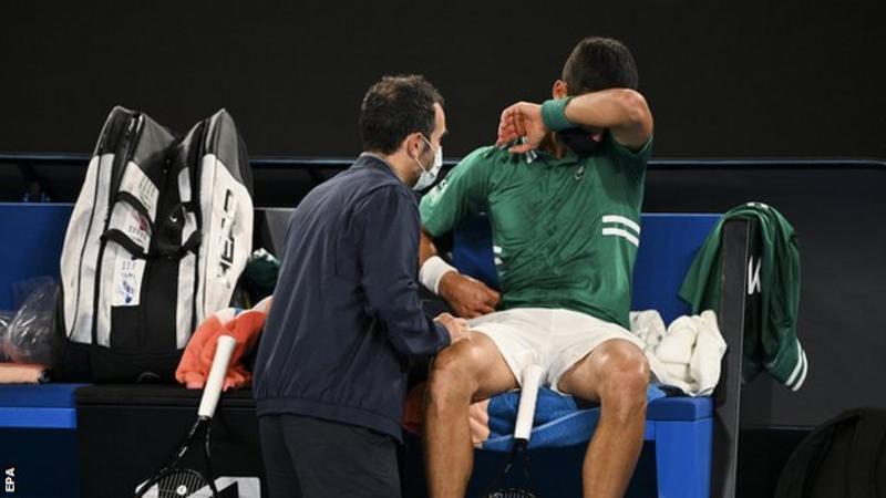 Australian Open: Novak Djokovic beats Taylor Fritz despite struggling with injury
