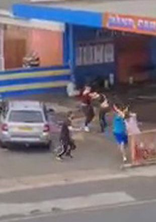 Mass brawl at car wash as men hit each other with metal poles and throw punches