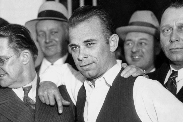 UNITED STATES - MARCH 06:  From left, Sheriff Lillian Holley and prosecutor Robert Estill stand with outlaw John Dillinger in Chicago.  (Photo by NY Daily News Archive via Getty Images)