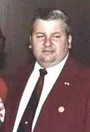 John Wayne Gacy in red suit